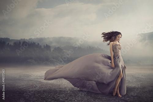 Plakaty Fantasy sensual-woman-walking-on-the-fantasy-ground