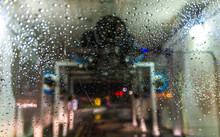 A Scene Of A Car Running Through Automatic Car Wash.