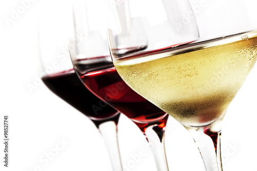 Fotobehang Alcohol Wine Glasses over White