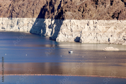Ship sails on Lake Mead at Hoover Dam Poster