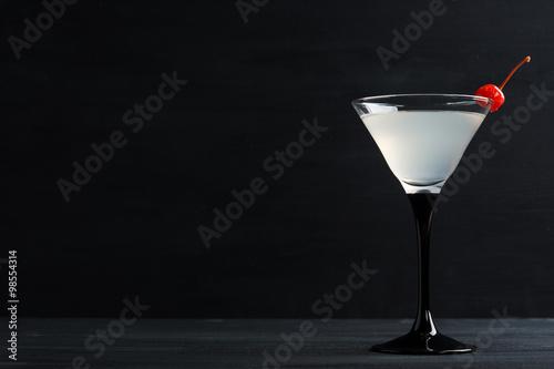 Fotografie, Obraz  Cocktail in martini glass on the black wooden background