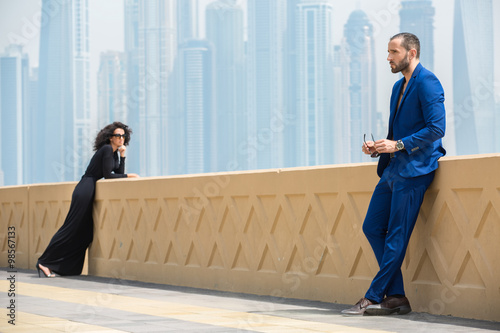 Photo  Couple on the background of skyscrapers