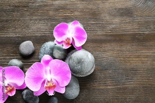 Fototapety, obrazy: Spa stones and orchids on wooden background