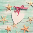 Marine items ( sea stars) and decorative heart on turquoise wo