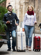 Mature couple walking with luggage
