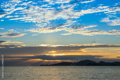 Foto op Aluminium Blauw Colorful of blue sky and golden sea in sunset time