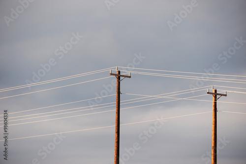 Fotografie, Obraz  power poles against cloudy sky