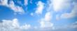 Leinwandbild Motiv Natural blue cloudy sky. Panoramic background