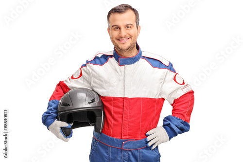 Young car racer holding a gray helmet