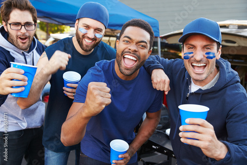 Fotografia, Obraz Group Of Male Sports Fans Tailgating In Stadium Car Park