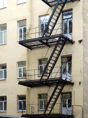 House with metal balconies and stairs