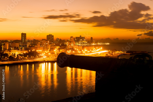 Sunset in Havana with a view of the city skyline and an old