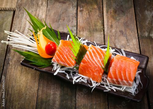 Photo  Salmon sashimi with teriyaki sauce