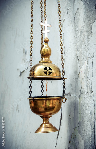 Valokuva  censer chain weighs nearly a white wall