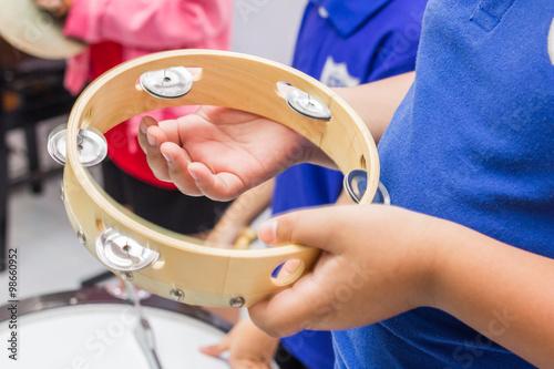 Fotografia The tambourine kid