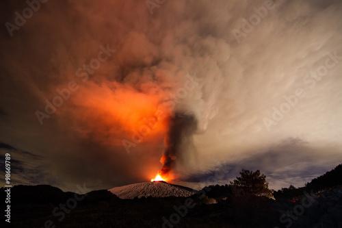 Volcano eruption. Mount Etna erupting from the crater Voragine Fototapeta