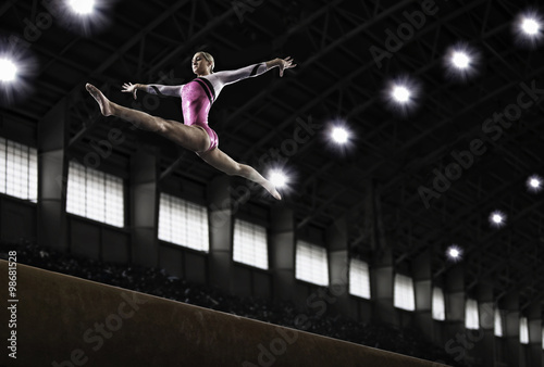 A gymnast with her arms outstretched leaping in the air Poster