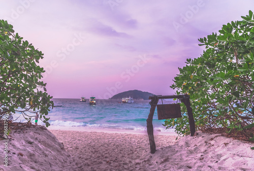 Printed kitchen splashbacks Purple Heaven like light purple sunset over sea and sandy beach,green bushes and with wooden tablet in Samui, Thailand