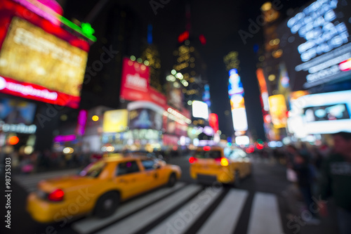 Staande foto New York TAXI Defocus view of Times Square signage, traffic, and holiday crowds in the lead-up to New Year's Eve