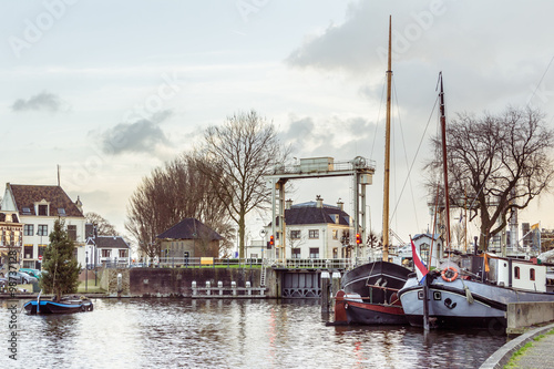 Fotografia  The museum harbor of Gouda in the Netherlands with monumental ships from the beginning of 1900