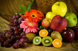 Assortment of exotic fruits on wood background.