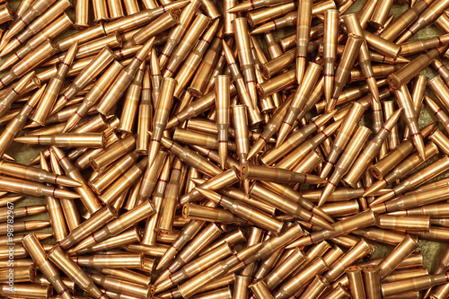 Fotomural ammo to machine guns as background