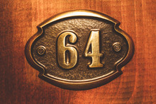 Apartment Number Sixty Four Close Up Photo.