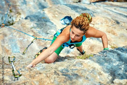 Fotografiet  female rock climber