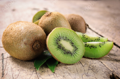 Fotografie, Tablou  Kiwi fruit on brown wooden background