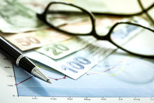 Business Chart And Eyeglasses