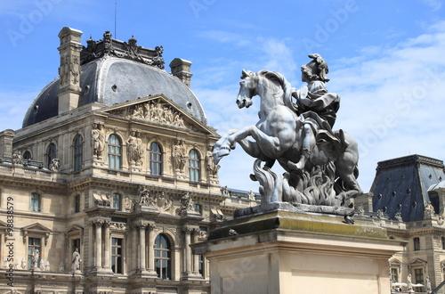 Photo Louvre Museum and the Louis XIV Equestrian statue. Paris, France