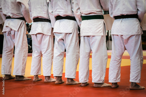 Fotografie, Obraz  closeup back group athletes of judoists standing tatami for judo