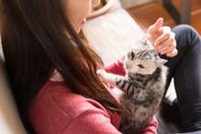 Asian Woman With Kitten