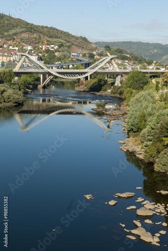 Modern bridge and water reflection