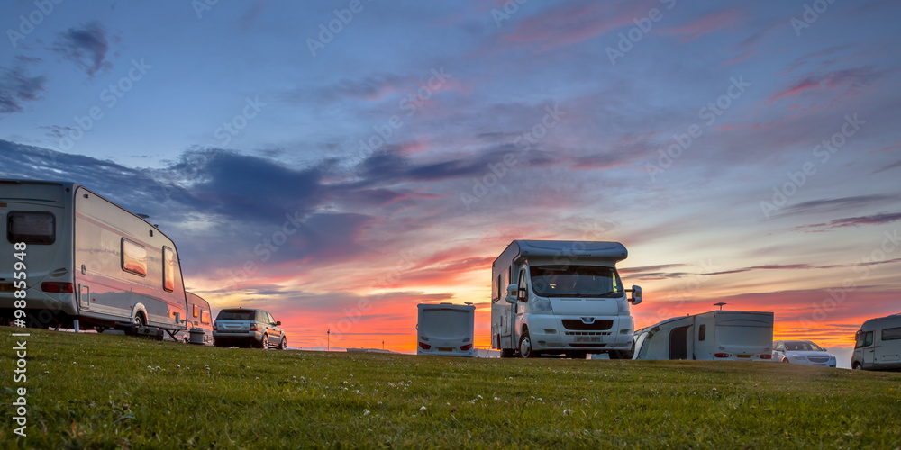 Fototapety, obrazy: Caravans and cars campsite sunset