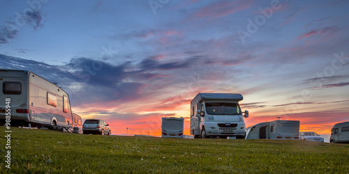 Spoed Foto op Canvas Kamperen Caravans and cars campsite sunset