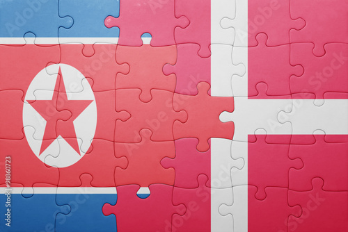 Photo  puzzle with the national flag of north korea and denmark