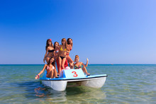 Group Of Six Young Women On A Pedalo Boat