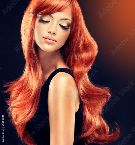 Obraz na plátně  Beautiful model girl  with long red curly hair