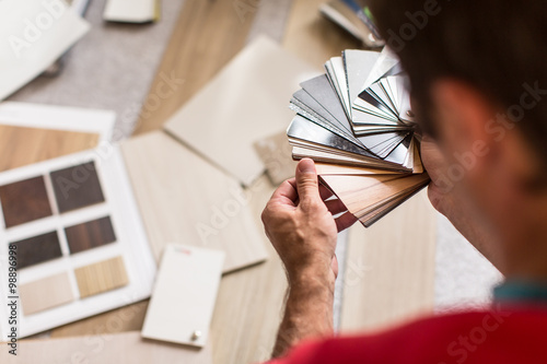 Fotografie, Obraz  Man chosing the right flooring for his house/appartement