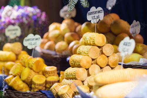 Fototapeta Traditional Polish smoked cheese (Oscypek) on a Christmas market stand in Krakow, Poland. obraz