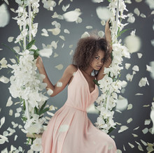 Pretty Mulatto Woman Among White Petals