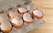 Broken Eggshells In Cardboard Carton
