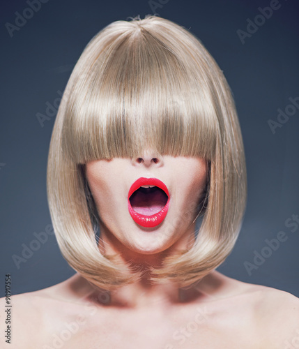 Fotografie, Obraz  Surprised young woman with a long fringe