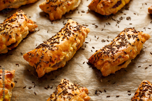 Spoed Fotobehang Voorgerecht Pasties with puff pastry stuffed with cabbage and mushrooms sprinkled with caraway seeds
