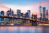 Fototapeta Bridge - Brooklyn Bridge at and the Lower Manhattan skyline under a purple sunset