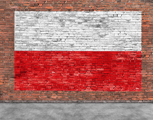FototapetaPolish flag painted on brick wall