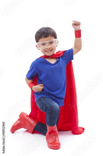 Photo  Little boy pretending to be a superhero on white background
