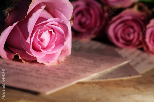Photo  Love letter with roses