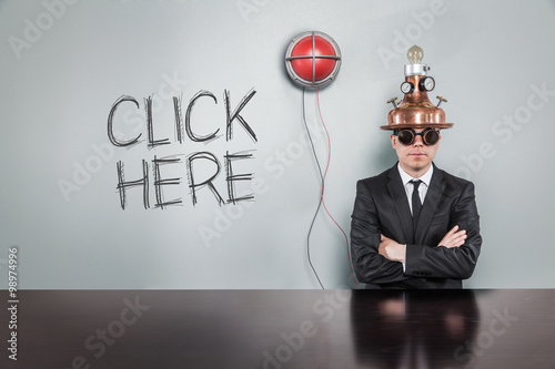Fotografía  Click here text with alert light and vintage businessman